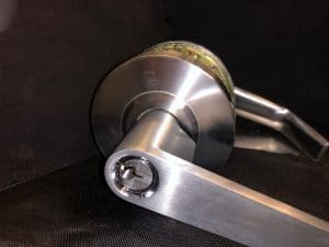 commercial-locksmith-in-fort-myers-FL-installing-lever-for-business--300x225